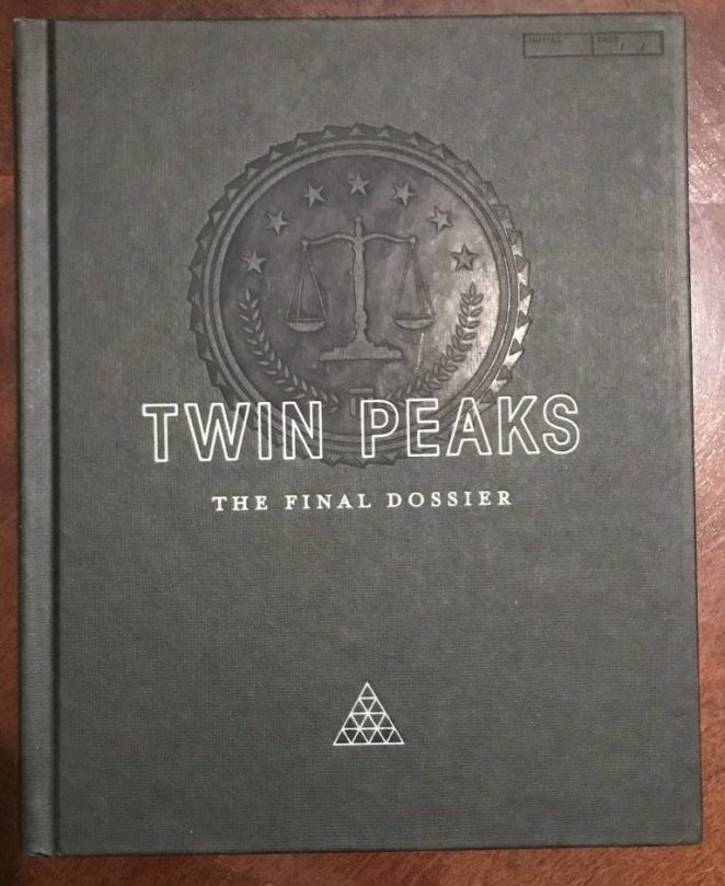 The front cover of the Final Dossier has the official FBI symbol in the center, scales of justice and all. Embossed over it is the title of the book. Near the bottom are triangles that form a larger triangle.