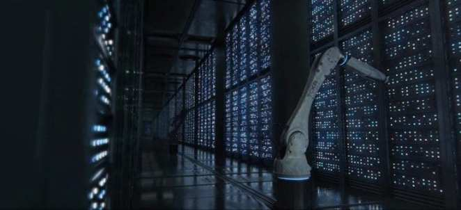 A robot arm plugs things in at a server farm