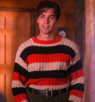 John Justice Wheeler wearing the greatest sweater known to man