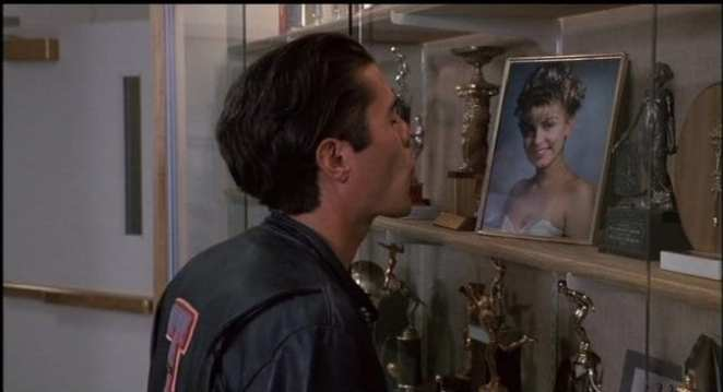 Bobby kisses the glass case holding Laura Palmers image