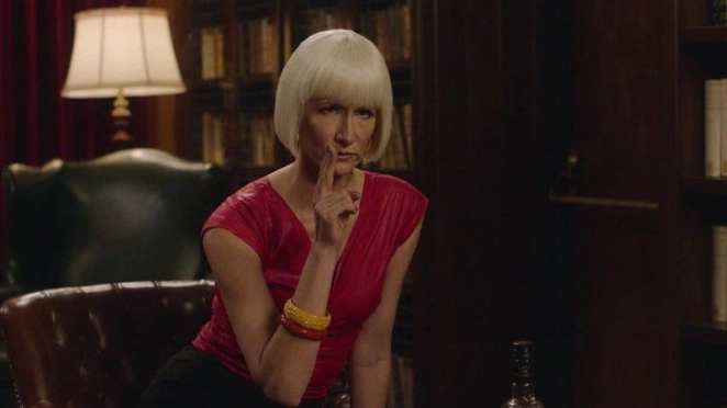 Diane holds 2 fingers up like a gun