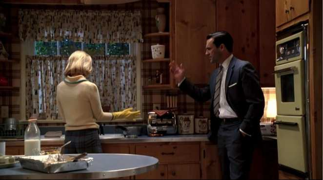 Betty and Don Draper argue in their kitchen