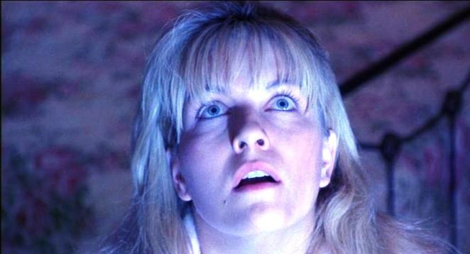 Laura Palmer looks up to her bedroom ceiling in wonder
