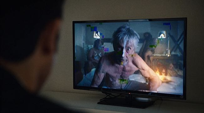 Kevin Garvey Sr. appears barely clothed on his son's TV screen with aborigines behind him