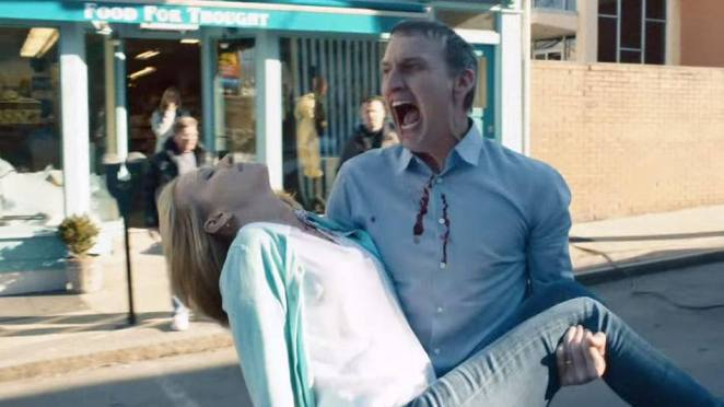 Matt screams as he holds Mary in his arms after the accident they suffered as a result of the Departure