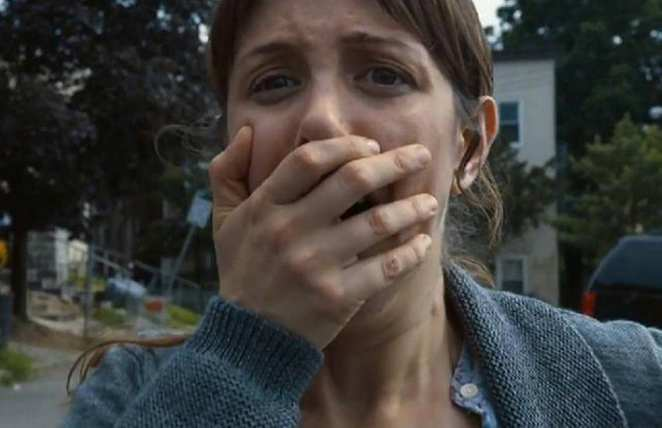 Sam's mother has her hand over her mouth as she witnesses the Departure