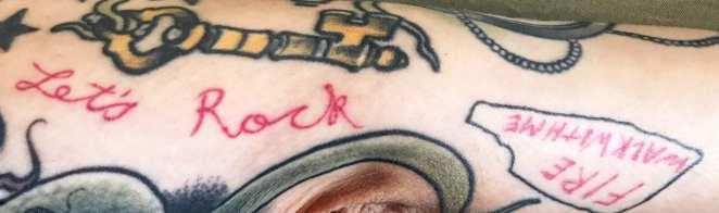 Gisela's Let's Rock tattoo