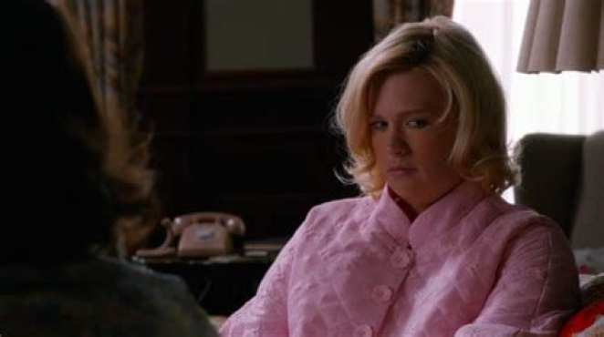 Betty has weight gain and wears a pink robe