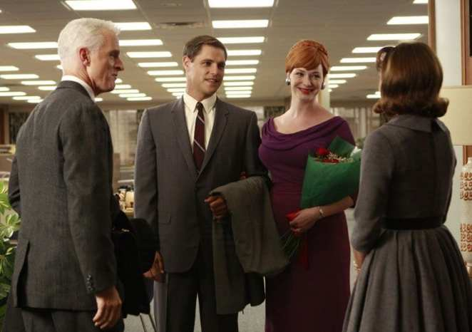 Joan with Peggy, Roger Sterling and her boyfriend in the office