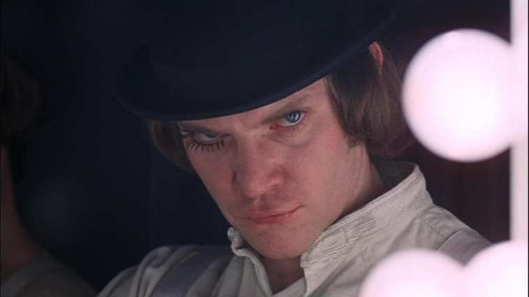 Malcolm McDowell stares creepily at the camera