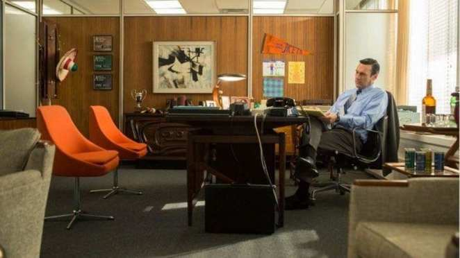 don draper sits alone in his office