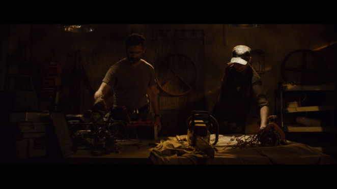 2 men prepare chainsaws for battle in Ghoul