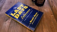 the last days of letterman book and a mug on a table