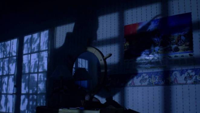 the shadow of Freddy Krueger on the bedroom wall of a child