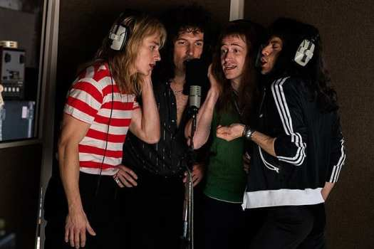 Left to right: Hardy, Lee, Mazzello, and Malek recreating a studio recording