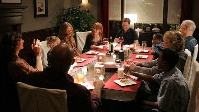 The entire Fisher family gathers around the dinner table