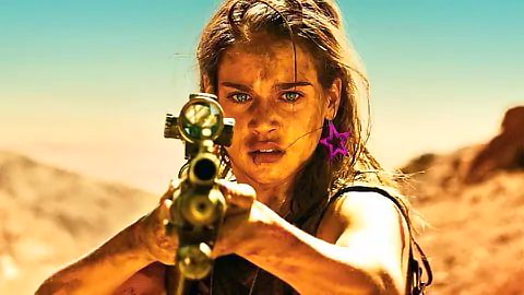 Jen points a gun at the camera in the desert
