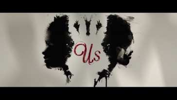 ink blot image two faces us