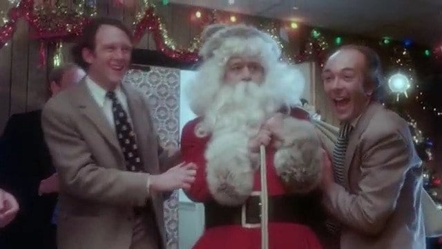 Harry has trouble with his co-workers in 1980's Christmas Evil.