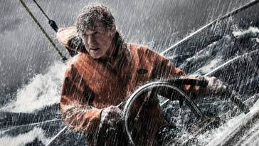Robert Redford trying to steer his boat in a storm