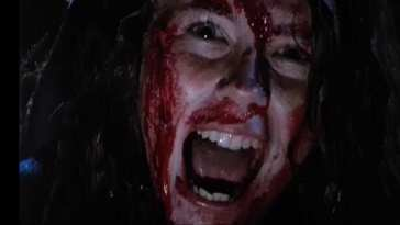 a woman screaming covered in blood