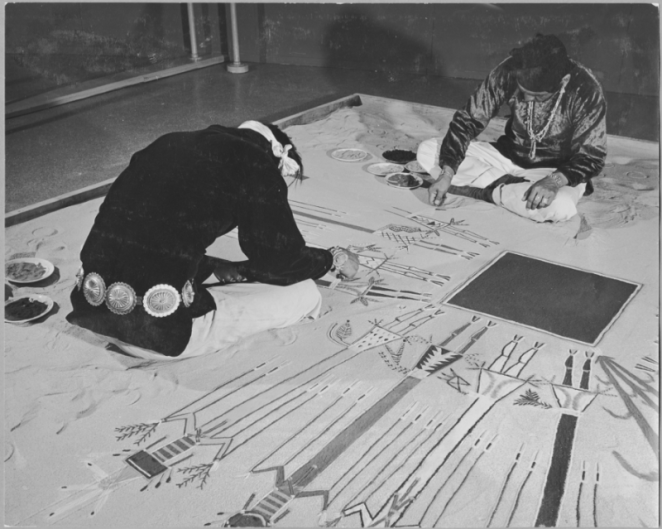 A black box at the center of the world. Here we see Navajo sand painters performing at the 1941 MOMA exhibition.