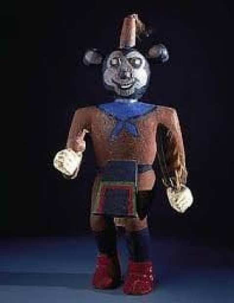 A wooden toy of Tusan Homichi, painted red and blue