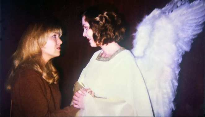 In this behind the scenes shot, Laura Palmer (Sheryl Lee) meets her angel.