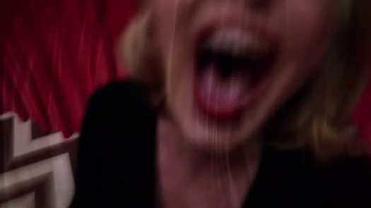 Laura being dragged from the Black Lodge