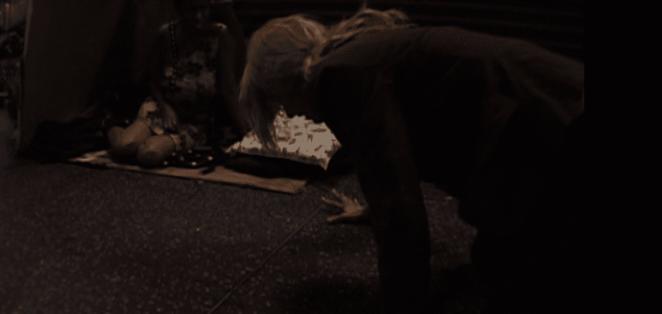 Laura Dern huddles over, dying, in David Lynch