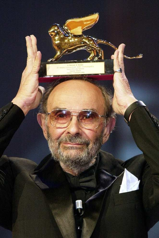 Stanley Donen holds up the Golden Lion award he won for lifetime achievement at the 61st edition of the Venice Film Festival in Venice, northern Italy, Saturday, Sept. 11, 2004