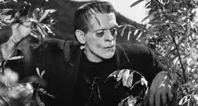 Frankenstein's monster looks through the trees