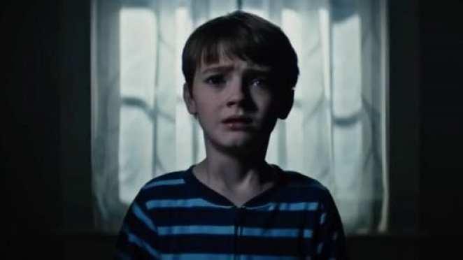 a little boy looks terrified