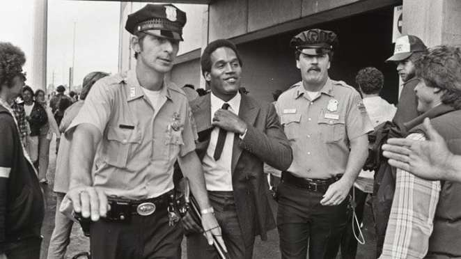 O.J. Simpson escorted by police in an image from the ESPN 30-for-30 documentary O.J.: Made in America