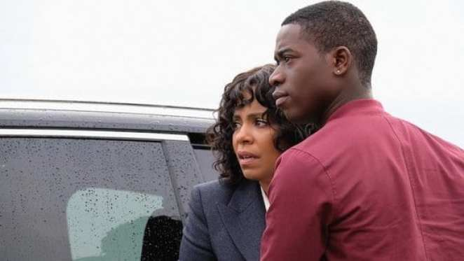 """Nina (Sanaa Lathan) and her son Dorian (Damson Idris) look on in fear at a police officer who won't leave them alone in The Twilight Zone """"Replay"""""""