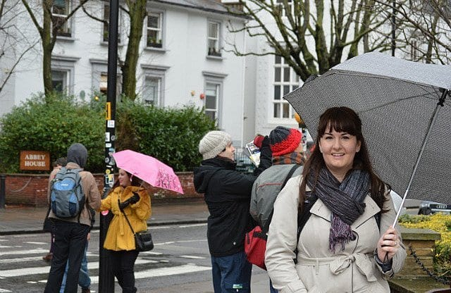 lindsay stamhuis stands in front of the abbey road zebra crossing