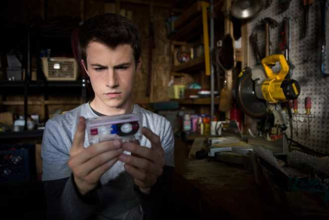Clay Jensen (Dylan Minnette) holds one of the tapes in his garage in 13 Reasons Why