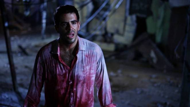 Eli Roth with a bloody shirt