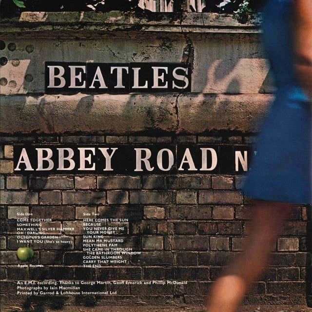 back cover of the beatles album abbey road showing track listing and paul is dead clues