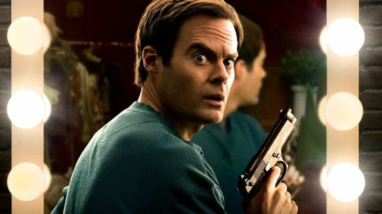 Barry (Bill Hader) holds a gun in front of a mirror in HBO's Barry