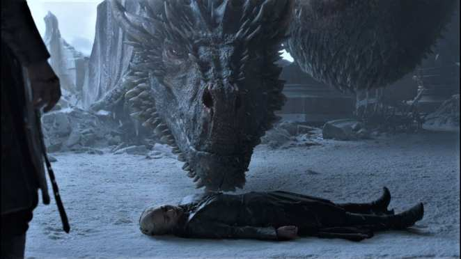 Drogon nudges the dead body of his mother Daenerys in the Game of Thrones finale