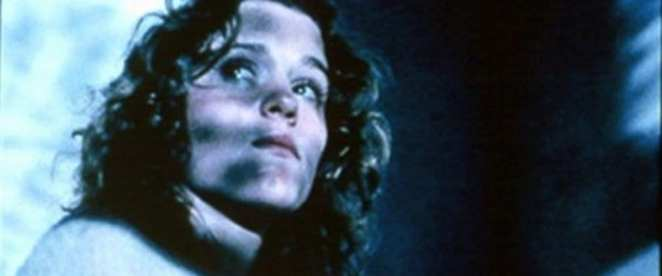 Abby (Frances McDormand) looks for someone lurking in the shadows.