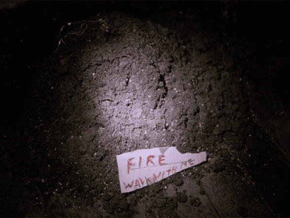 fire walk with me written in blood on a scrap of paper left in dirt