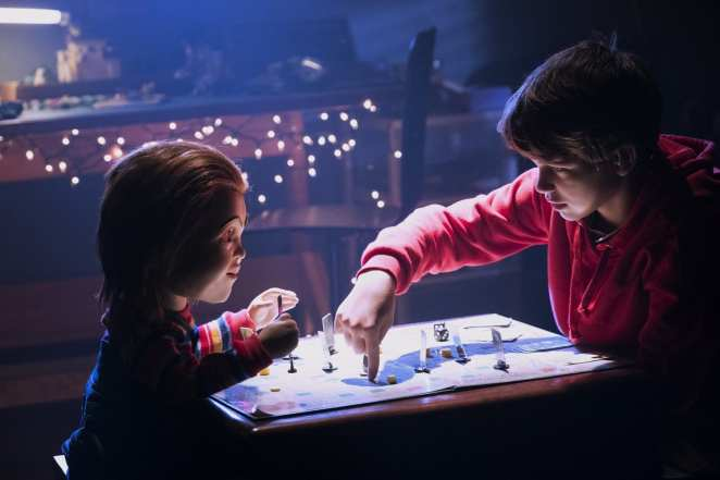Andy (Garbiel Bateman) and Chucky (Mark Hamill) play a game in Child's Play (2019)