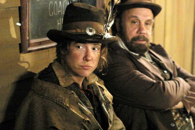 Jane sits next to Charlie Utter in Deadwood