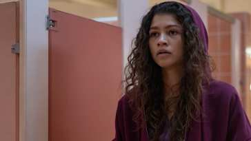 Rue (Zendaya) wearing a red hooded sweatshirt in the bathroom in HBO's Euphoria