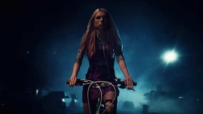 Jules rides her bike at night in HBO's Euphoria