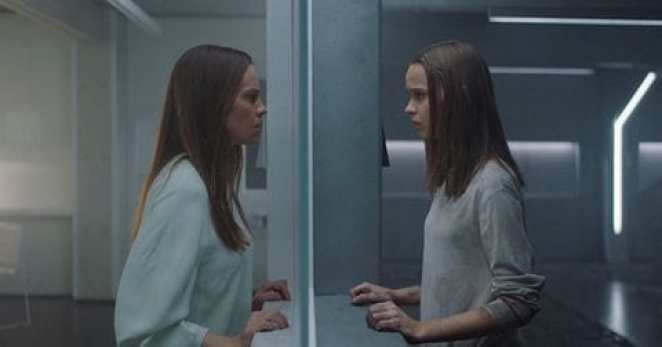 Woman (Hilary Swank) enters Mother and Daughter's bunker, exposing the horrific truth of Mother's lies.