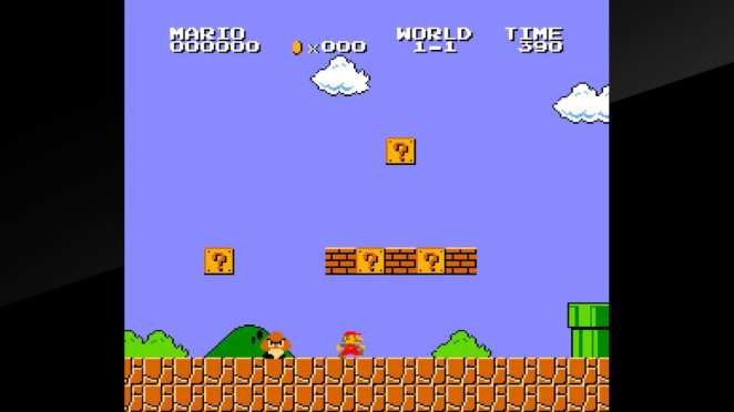 A typical scene in Super Mario Brothers, with Mario running along a course made of bricks, bad guys, and obstacles.