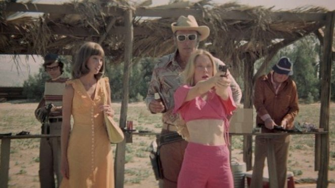 Pinky (Sissy Spacke) shooting guns with Edgar (Robert Fortier) as MIllie (Shelley Duvall) stares in disbelief that this is the same Pinky.